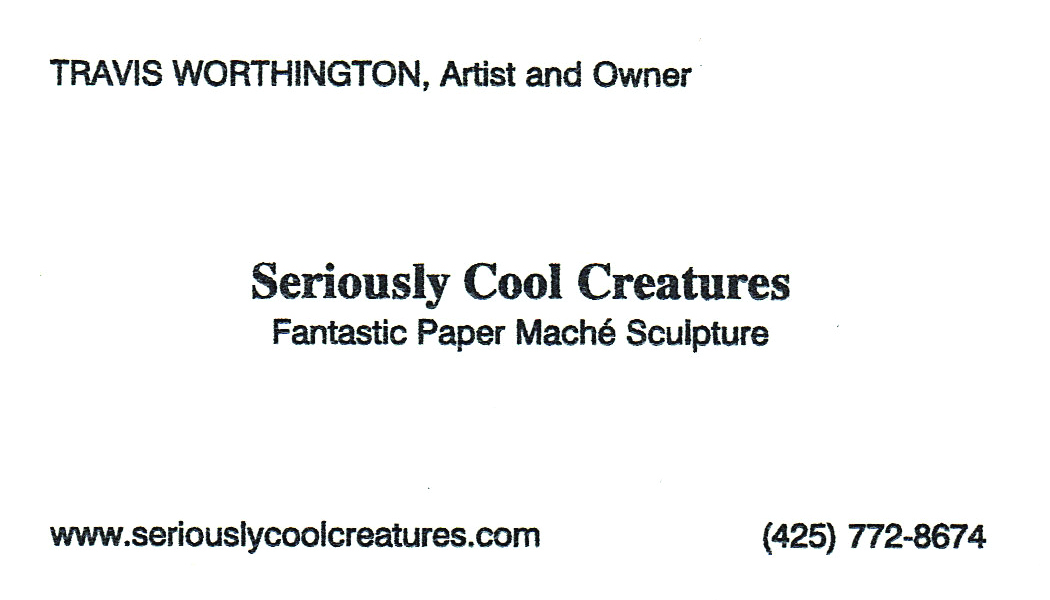 Travis' current business card, front side.